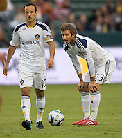 LA Galaxy marquee players Landon Donovan (l) and David Beckham (r) line up on a freekick. The LA Galaxy defeated FC Dallas 2-1 at Home Depot Center stadium in Carson, California on Sunday October 24, 2010.