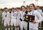 NEW BRITAIN, CT-111817JS04- Lewis Mills' seniors, from left, Joe Neary (23), Braden Fox (2),Matt Gilbert (12), Peter Christiano (10) and John Mudgett (14)  poses with the championship plaque following their 3-2 win over Suffield to capture the Class M state title Saturday at Willow Brook Park in New Britain.<br /> Jim Shannon Republican-American