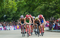 07 AUG 2012 - LONDON, GBR - Gavin Noble (IRL) of Ireland (in green with red bike helmet) leads a pack during the bike at the men's London 2012 Olympic Games Triathlon in Hyde Park, London, Great Britain (PHOTO (C) 2012 NIGEL FARROW)