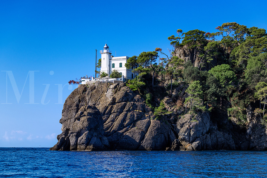Lighthouse guiding ships into Portofino harbor.