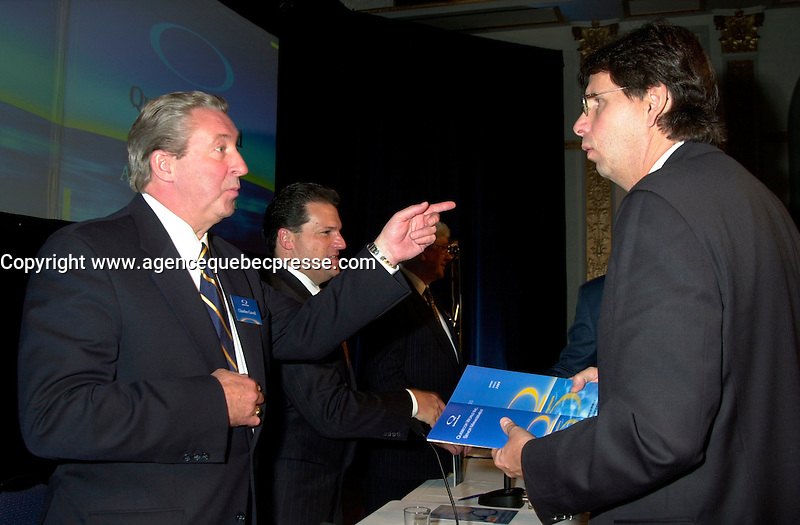 Montreal, April 4rd 2001<br /> Charles G&quot; Cavell,Quebecor World President and CEO (left)  speaks with Quebecor Vice-Chairman of the Board : Erik Peladeau at <br /> Quebecor World annual meeting, April 4th 2001, in Montreal, CANADA<br /> Since the `` Merger of equals `` between Quebecor Printing and World Color, the company operating margin reached a record high of 11.1 % for the year ; revenues increased by 32 % to 6.5 billion US $ ; operating income increased by 53 % to 724.8 Million US $  and net income increased by 43 % to 293.4 Million US $, or 1,93 US $ per share.<br /> Quebecor World is now the largest and strongest performing entity in the printing field<br /> Photo by Pierre Roussel/