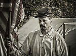 Civil War Union Soldier next to the flag HDR