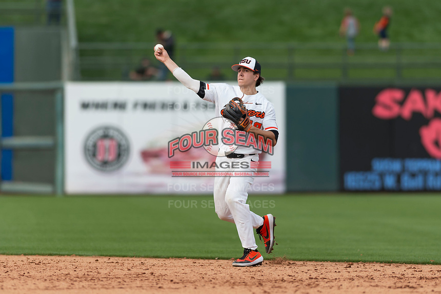 Oregon State Beavers second baseman Ryan Ober (18) makes a throw to first base during a game against the New Mexico Lobos on February 15, 2019 at Surprise Stadium in Surprise, Arizona. Oregon State defeated New Mexico 6-5. (Zachary Lucy/Four Seam Images)