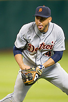 Detroit Tigers second baseman Omar Infante (4) fields a ground ball during the MLB baseball game against the Houston Astros on May 3, 2013 at Minute Maid Park in Houston, Texas. Detroit defeated Houston 4-3. (Andrew Woolley/Four Seam Images).