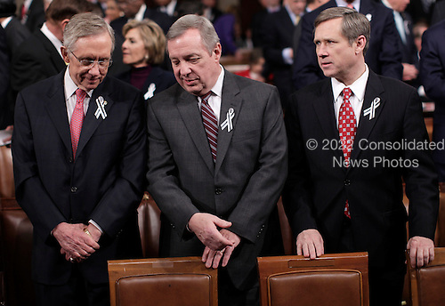 From left, Senate Majority Leader Harry Reid of Nev., Senate Majority Whip Richard Durbin of Ill., and Sen, Mark Kirk, R-Ill., are seen on Capitol Hill in Washington, Tuesday, Jan. 25, 2011, during President Barack Obama's State of the Union address .  .Credit: Pablo Martinez Monsivais / Pool via CNP