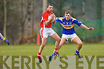 Damian Somers St Senans keeps tight on Niall Lynch Kilgarvan during their Novice Championship clash in Kilgarvan on Saturday