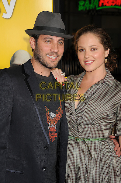 "BRAD FURMAN & MARGARITA LEVIEVA .at the Los Angeles premiere of ""Paul"" at Grauman's Chinese Theatre in Hollywood, California, USA, .March 14th, 2011. .half  length black jacket jeans trainers hat dress checked check shirt belt green brown .CAP/ROT/TM.©TM/Roth/Capital Pictures"