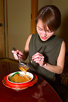 woman serving shark fin stew or soup, made of juvenile blue shark fins, Prionace glauca, one of the most expensive Chinese cuisine, Tokyo, Japan