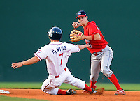 July 29, 2009: Zach Gentile (7) of the Greenville Drive makes a wide slide into second base but is forced out by Lakewood BlueClaws  shortstop Korby Mintkin (11) in a game at Fluor Field at the West End in Greenville, S.C. Photo by: Tom Priddy/Four Seam Images