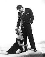 1953: Gloria Grahame (1923 - 1981) as Debby Marsh and Glenn Ford as Dave Bannion from the film, 'The Big Heat', directed by Fritz Lang and produced by Columbia Pictures Corporation.