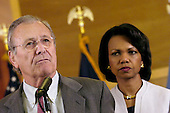 United States Secretary of Defense Donald H. Rumsfeld speaks to reporters as US Secretary of State Condoleezza Rice listens in Baghdad, Iraq, on April 27, 2006.  Rumsfeld and Rice made an unannounced visit to Iraq to meet with senior military commanders and government officials, including Iraq's new Prime Minister designate Jawad al-Maliki. <br /> Mandatory Credit: Chad J. McNeeley / DoD via CNP