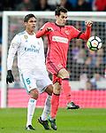 Real Madrid's Raphael Varane (l) and Real Sociedad's Juanmi Jimenez during La Liga match. February 10,2017. (ALTERPHOTOS/Acero)