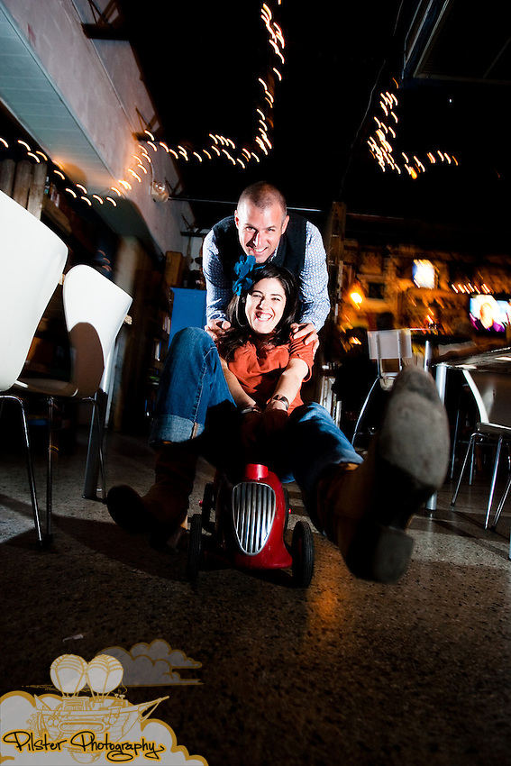 Nicolle Avery and John Masters during their engagement session on Saturday, February 13, 2010, at Stardust Coffee in Orlando, Florida. They started at Kraft Azalea Garden in Winter Park. This is where John had propsed. They then moved to Stardust Cofee, Orlando's oldest coffee house, where they had met for the first time.  (Chad Pilster, http://www.PilsterPhotography.net)