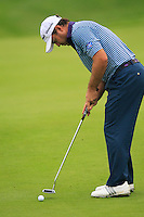 Richard Sterne (RSA) putts on the 9th green during Thursday's Round 1 of the 2014 BMW Masters held at Lake Malaren, Shanghai, China 30th October 2014.<br /> Picture: Eoin Clarke www.golffile.ie