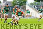 Darran O'Sullivan Mid Kerry goes past Nathan Breen Mid Kerry St Brendans during their County Championship game in Fitzgerald Stadium on Sunday