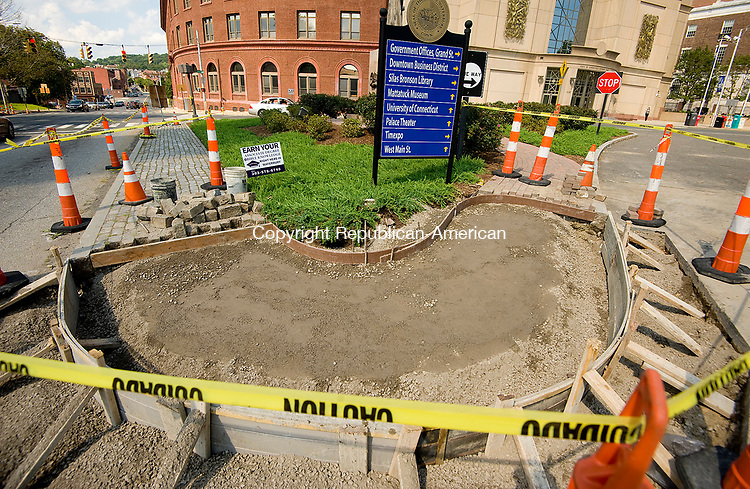 WATERBURY, CT-080317JS06-- The state Department of Transportation is reconstructing the sidewalks and curb cuts at 32 intersections in and around downtown Waterbury, including those around Meadow and Grand Streets . The improvements will bring the intersections to compliance for handicapped accessibility. <br /> Jim Shannon Republican-American