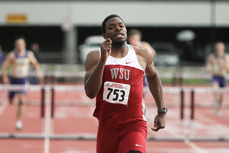 Jeshua Anderson, Washington State junior, blows away his competition in the 400 meter hurdles during the Cougars dual track and field meet with arch-rival Washington at Mooberry Track at Washington State University in Pullman, Washington, on May 1, 2010.