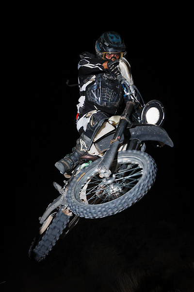 A motocross rider jumps through the night during and MRAN night race in Logandale, NV.
