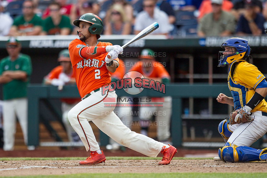 Miami Hurricanes designated hitter Randy Batista (2) follows through on his swing against the UC Santa Barbara Gauchos in Game 5 of the NCAA College World Series on June 20, 2016 at TD Ameritrade Park in Omaha, Nebraska. UC Santa Barbara defeated Miami  5-3. (Andrew Woolley/Four Seam Images)