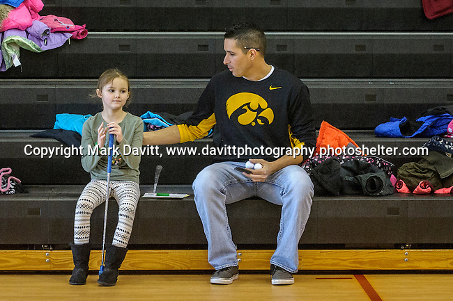 Chance Curphy and his daughter Reese talk while waiting for the rest of their family members to arrive for golf at the fourth annual 4th Altoona Elementary Golf in the Halls was held Jan. 28. Participants enjoyed a breakfast and  two, 18-hole mini-golf courses throughout the school's classrooms, hallways and gymnasiums.