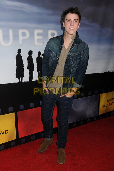 "Sterling Beaumon.""Super 8"" DVD/Blu-ray Release Screening held at the Academy of Motion Picture Arts & Sciences Samuel Goldwyn Theater, Beverly Hills, California, USA..November 22nd, 2011.full length jean jeans denim jacket double hands in pocket beige shirt .CAP/ADM/BP.©Byron Purvis/AdMedia/Capital Pictures."