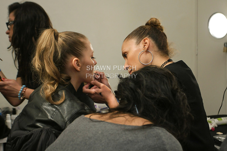 Makeup For Ever makeup artist, applying makeup to model, backstage at the bebeBlack Fall 2011 fashion show, during Style 360 Fashion Week Fall 2011.