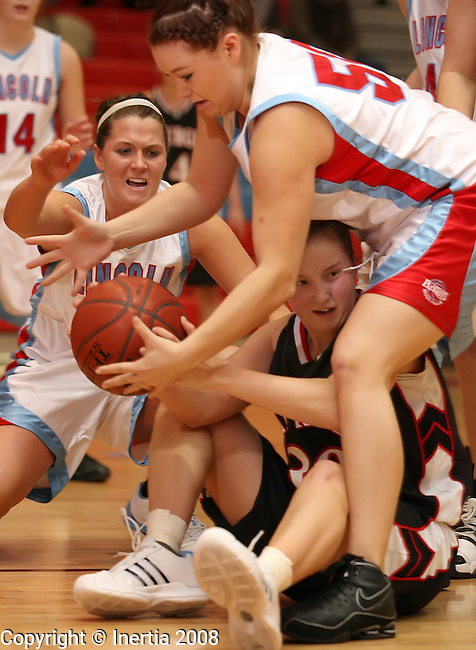 SIOUX FALLS, SD - January 9:  Alyssa Gouldin #30 of Sturgis looks for help as Ellen Reinecke #20 and Beckah Herther #50 from Lincoln apply pressure in the second half of their game Friday night at Lincoln. (Photo by Dave Eggen/Inertia)