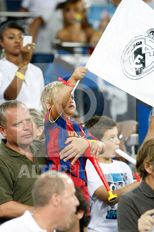 FC Barcelona's kid supporter with a Real Madrid's flag during Spanish Supercup 1st match.August 14,2011. (ALTERPHOTOS/Acero)