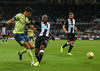 9th November 2019; St James Park, Newcastle, Tyne and Wear, England; English Premier League Football, Newcastle United versus AFC Bournemouth; Dominic Solanke of AFC Bournemouth crosses the ball with Jetro Willems of Newcastle United challenging - Strictly Editorial Use Only. No use with unauthorized audio, video, data, fixture lists, club/league logos or 'live' services. Online in-match use limited to 120 images, no video emulation. No use in betting, games or single club/league/player publications