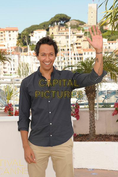 director Oliver Hermanus attend the  'Skoonheid' photocall at the Palais des Festival, 64th International Cannes Film Festival, France.17th May 2011.half length grey gray shirt hand arm waving tattoos.CAP/PL.©Phil Loftus/Capital Pictures.