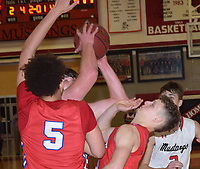 RICK PECK/SPECIAL TO MCDONALD COUNTY PRESS<br /> McDonald County's Cooper Reece scores two of his 26 points despite being double-teamed by Seneca's Brennen Yust (5) and Gavin Clouse during the Mustangs' 59-52 loss to Seneca on Jan. 11 at MCHS.