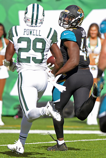 Jacksonville Jaguars linebacker Myles Jack (44) looks back and smiles at New York Jets running back Bilal Powell (29) as he returns a fumble recovery 81 yards for a touchdown with 10:20 to play in the fourth quarter in a NFL game Sunday, October 1, 2017 in East Rutherford, NJ. (Rick Wilson/Jacksonville Jaguars)