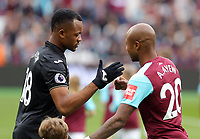 (L-R) Jordan Ayew of Swansea City greets his brother Andre Ayew of West Ham during the Premier League match between West Ham United v Swansea City at the London Stadium, London, England, UK. Saturday 30 September 2017