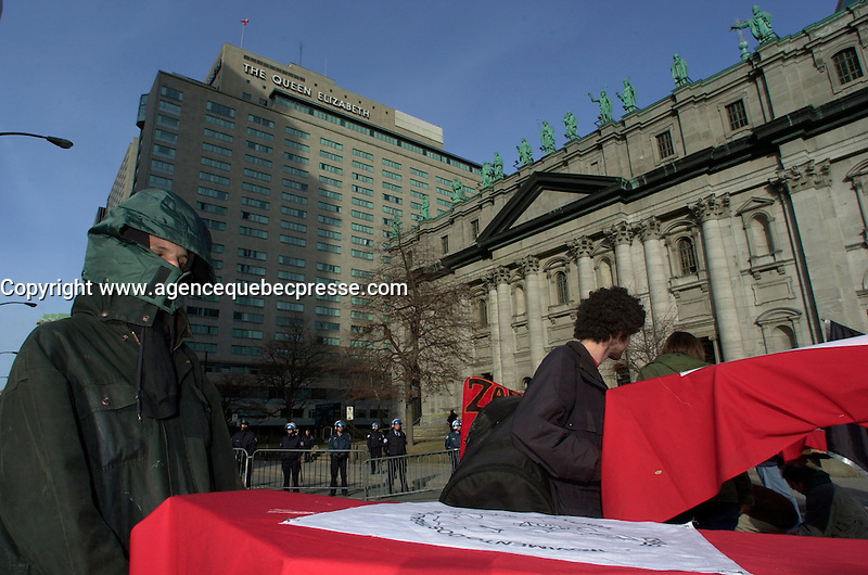 Montreal, April 17, 2001<br /> A group of demonstrators opposed to the Free Trade Area of the Americas (FTAA) leaves with coffins symbolizing the victims of the world globalization<br /> on April 17, 2001 in downtown Montreal (Quebec, CANADA), near the Queen Elizabeth Hotel where the `` Conference of Montreal `` on economy globalization is beeing held until April 19th 2001.<br /> <br /> The  conference feature speakers such as Mexico President Foxx and New York Governor Pataki.<br /> <br /> Photo by Pierre Roussel / <br /> NOTE :  Uncorrected D-1 JPEG saved as Adobe RGB color space.