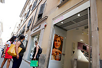 Roma May 18th 2020. Covid-19 Italy further relaxes lockdown. Today a Council of Minister's decree will allow almost all the activity to reopen. Clothes shops, shopping centers, hairdresser and churches for religious services. <br /> Photo Samantha Zucchi Insidefoto