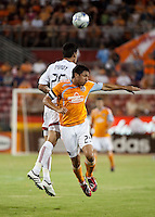FC Dallas defender Steve Purdy (25) and Houston Dynamo forward Brian Ching (25) go up for the header.  Houston Dynamo defeated FC Dallas 1-0 at Robertson Stadium in Houston, TX on May 9, 2009