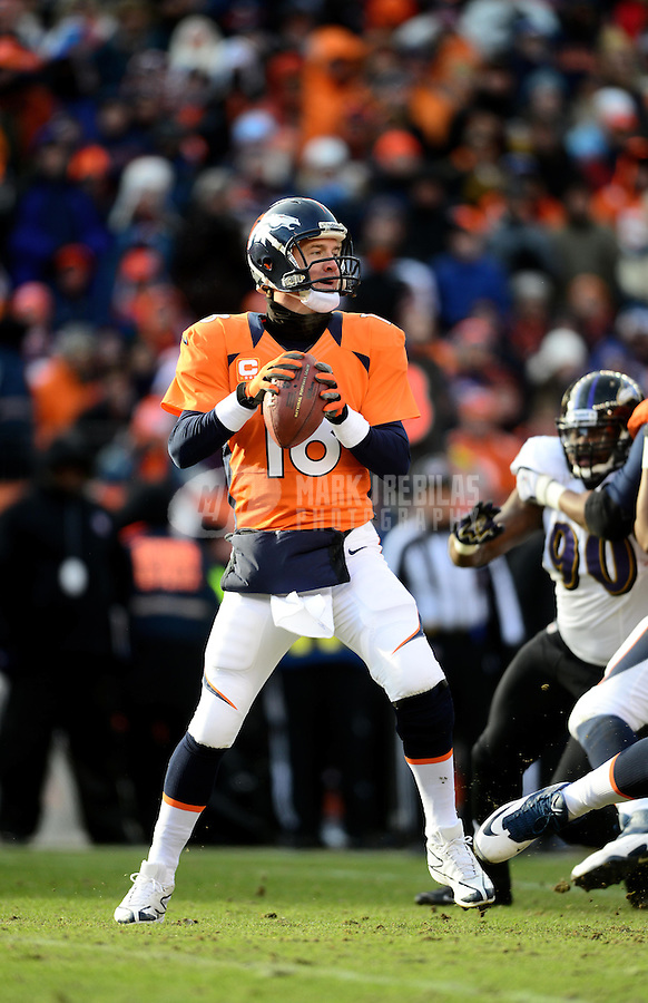 Jan 12, 2013; Denver, CO, USA; Denver Broncos quarterback Peyton Manning (18) against the Baltimore Ravens during the AFC divisional round playoff game at Sports Authority Field.  Mandatory Credit: Mark J. Rebilas-
