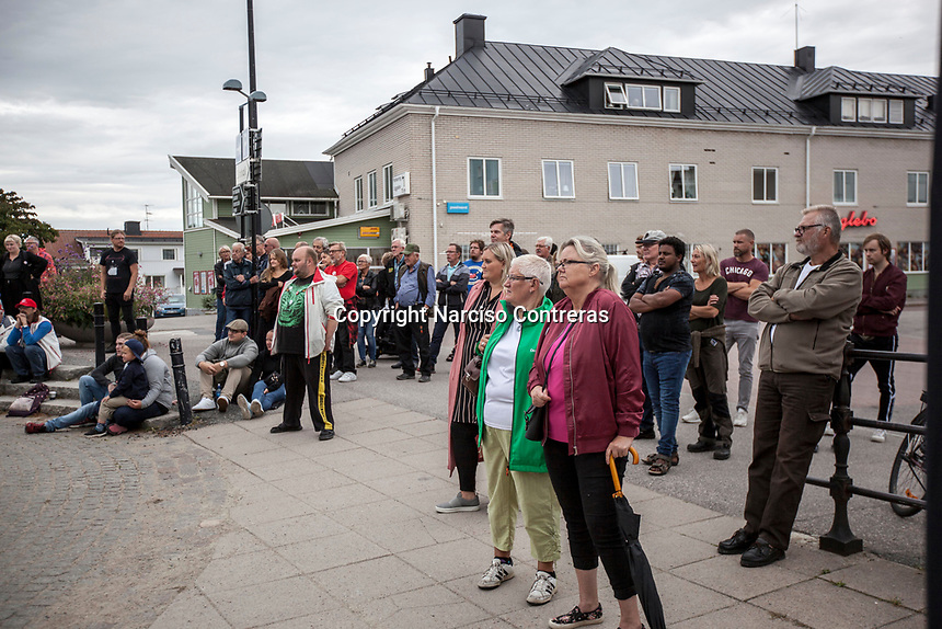 August 30, 2018: Voters attend a public debate held in the main square of Ockelbo municipality, between members of the Swedish Democrats (Sverigedemokraterna) and members of the Social Democrats party (Socialdemokraterna) -not pictured-.