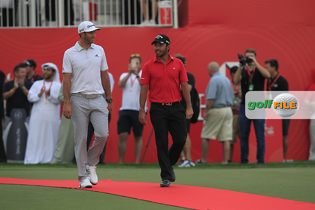 Dustin Johnson (USA) and Pablo Larrazabal (ESP) walk up to collect their Runner-up prizes at the Abu Dhabi HSBC Championship on Sunday 22nd January 2017.<br /> Picture:  Thos Caffrey / Golffile<br /> <br /> All photo usage must carry mandatory copyright credit     (&copy; Golffile | Thos Caffrey)