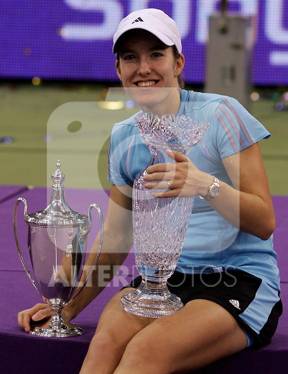 Belgium's, Justine Henin-Hardenne, poses with the trophies after Madrid Masters Tennis Final, match between Amelie Mauresmo and Justine Henin-Hardenne in Madrid Arena,Sunday November 12 2006. (ALTERPHOTOS/B.echavarri).