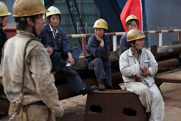 Workers gather before launching the 57,000 dead weigh ton bulk carrier Sabina Venture into the Yangzte River at the China CSSC Holdings Ltd. Chengxi Shipyard in Jiangyin, China, on Sunday, Sept. 12, 2010. China CSSC Holdings Ltd., the nation's biggest shipyard, sees orders surge as China's voracious appetite for commodities demands more fleets of large vessels.