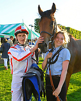 Winner of The Derek Burridge Golf & Racing Trophies Handicap Twenty Years On (red/white) ridden by Finley Marsh and trained by Richard Hughes in the Winners enclosure during Evening Racing at Salisbury Racecourse on 25th May 2019