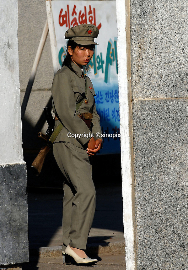 "Female North Korean soldier in Pyongyang, North Korea. The DPRK (Democratic People's Republic of Korea) is the last great dictatorship where the people are bombarded with images of the ""Eternal President"" Kim Il-sung who died in 1994 and his son and current leader Kim Jong-il who are worshipped like a God."