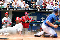 Philadelphia Phillies Manager Charlie Manuel watches as second baseman Abraham Nunez slides past catcher John Buck to score on a Jimmy Rollins double to left field during the fourth inning at Kauffman Stadium in Kansas City, Missouri on June 10, 2007.  The Royals won 17-5.