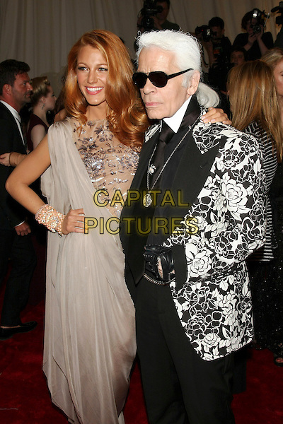 "BLAKE LIVELY & KARL LAGERFELD .attending the Metropolitan Museum of Art's Costume Institute Gala ""Alexander McQueen: Savage Beauty"" held at the Metropolitan Museum of Art, New York, NY, USA, May 2nd 2011..half length chanel dress hand on hip silver grey gray tanned  mesh nude  print patterned  metal embellished floral flowers designer jacket black white sunglasses  gloves necklace collar .CAP/LNC.©TOM/LNC/Capital Pictures."