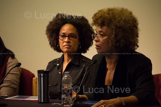 (From L to R) Gina Dent &amp; Angela Davis. <br /> <br /> London, 13/12/2013. Today, War on Want, School of Law at SOAS and the Russell Tribunal on Palestine presented a meeting called &quot;On Palestine, G4S and the Prison Industrial Complex&quot;, hosted by Angela Davis (American political activist, scholar, and author. She emerged as a nationally prominent activist in the 1960s, as a leader of the Communist Party USA, and had close relations with the Black Panther Party through her involvement in the Civil Rights Movement despite never being an official member of the party. She is the founder of Critical Resistance, an organization working to abolish the prison-industrial complex. She is a Distinguished Professor Emerita of History of Consciousness and Feminist Studies at University of California, Santa Cruz), Gina Dent (American political activist, writer and scholar, known for her leadership in the Black civil rights movement and her pioneering work against the prison industrial complex; she is Associate Professor in the Feminist Studies Department, History of Consciousness, and Legal Studies, University of California, Santa Cruz, and  she is a leading global advocate for human rights and prison abolition) and Rafeef Ziadah (Senior Campaigns Officer at War on Want, speaking on G4S: the business of repression and the challenge of solidarity). Chair of the event were Brenna Bhandar (Senior Lecturer, School of Law at SOAS) and Frank Barat (Coordinator, Russell Tribunal on Palestine).<br /> <br /> For more information about this event please click here: http://bit.ly/1cydHcF<br /> <br /> For videos of the event please click here: http://bit.ly/1gPZcrL