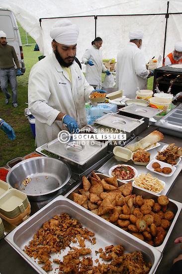 Men preparing food in a tent at the Nottingham Mela,