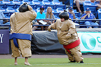 St. Lucie Mets sumo wrestling on field promotion during a game against the Charlotte Stone Crabs at Digital Domain Ballpark on June 20, 2011 in Port St Lucie, Florida.  St. Lucie defeated Charlotte 3-2 in 11 innings.  (Mike Janes/Four Seam Images)