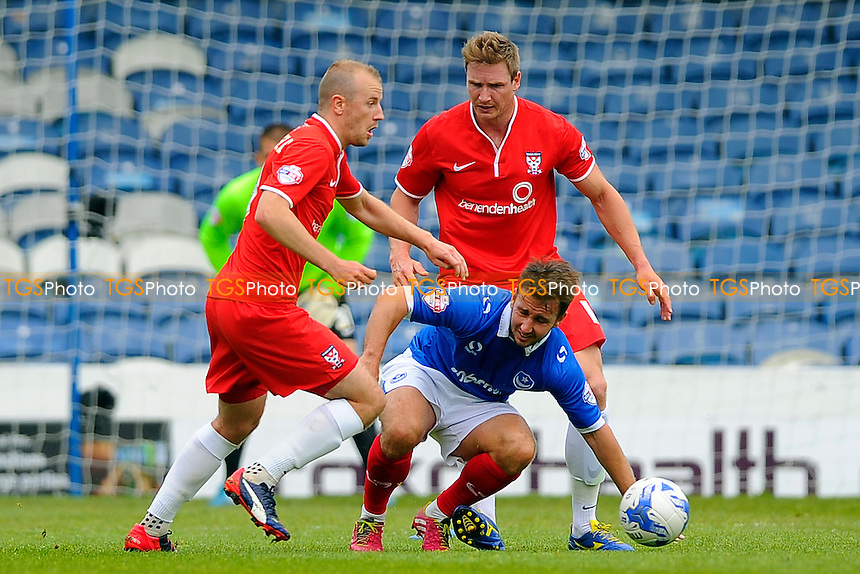 Matt Tubbs of Portsmouth middle is crowded out by  Luke Summerfield of York City and Dave Winfield of York City- Portsmouth vs York City - Sky Bet League Two Football at Fratton Park, Portsmouth, Hampshire - 02/05/15 - MANDATORY CREDIT: Denis Murphy/TGSPHOTO - Self billing applies where appropriate - contact@tgsphoto.co.uk - NO UNPAID USE