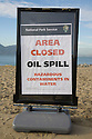 "An ""Area Closed, Oil Spill, Hazardous Contaminents (sic) In Water"" sign from the National Park Service stands in front of the beach at Crissy Field in San Francisco(11/12/07). On November 7, 2007 the Cosco Busan container ship spilled an estimated 58,000 gallons of bunker fuel into San Francisco Bay after striking a tower of the San Francisco-Oakland Bay Bridge."